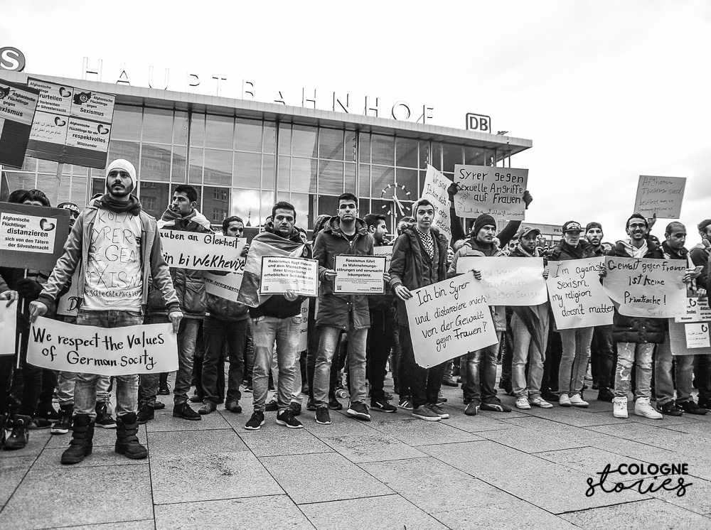 Refugees and Germans protest sexism and racism :#colognestories